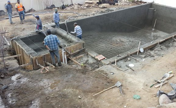 Custom swimming pool construction experts impressions landscape for Swimming pool construction company